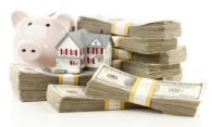 Small House and Piggy Bank with Stacks Money